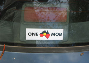 ONE MOB sticker on a car – the text is around an Aboriginal flag superimposed onto a map of Australia