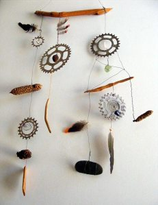 wallhanging made of wood, stone, feathers, wire, bicycle cluster, banksia