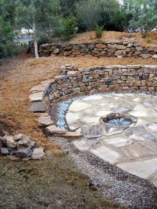 garden feature – drystone retaining walls, one in the shape of a spiral