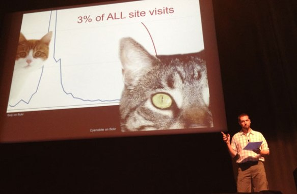 Nate Solas presenting a large-screen image of the long tail of cat videos